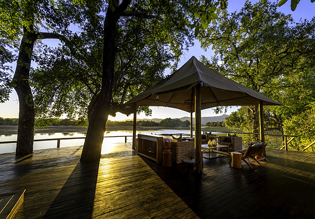 Chindeni BushCamp at dawn. Undoubtedly one of the best tented camps in the South Luangwa. Located on the edge of a permanent lagoon where the Chindeni Hills serve as a backdrop from the deck.